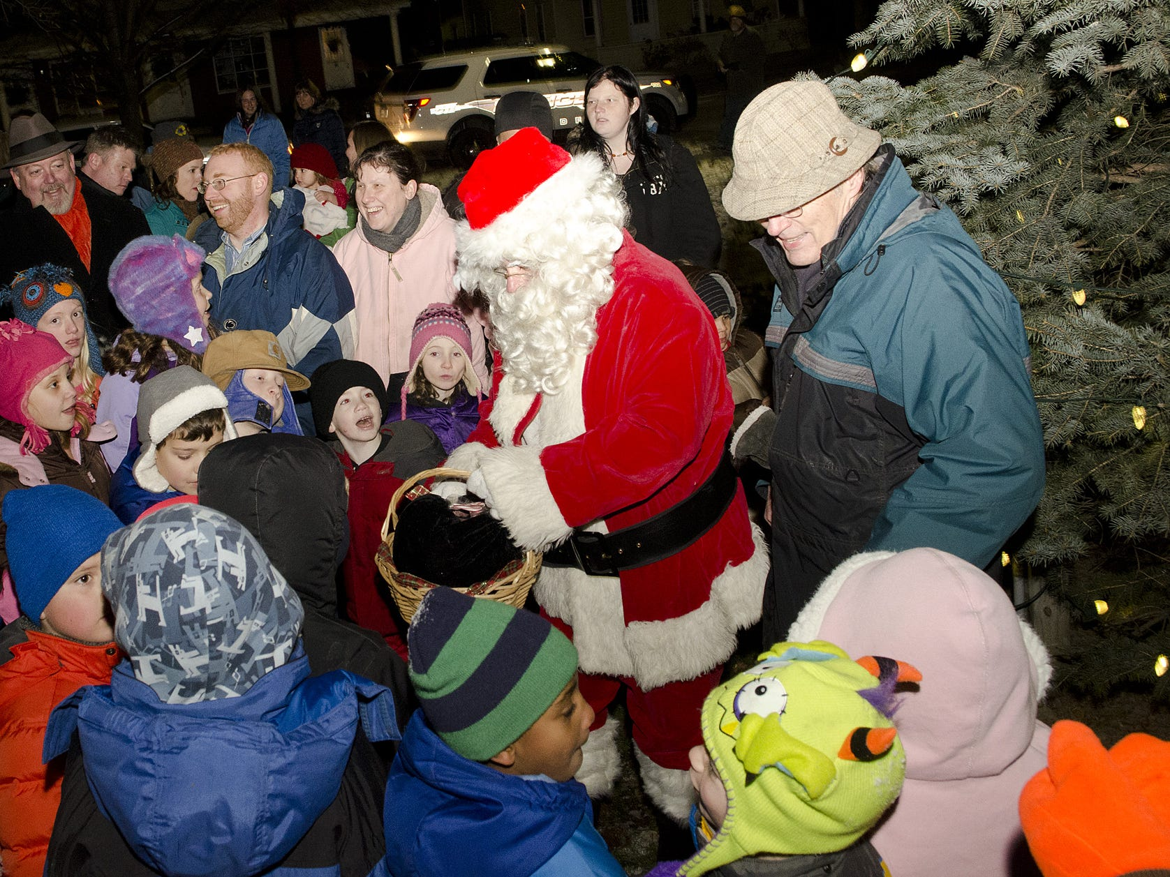 Santa Claus hands out candy to children in 2013 at the annual holiday tree lighting festival in Dryden. After switching on the tree, he went inside the Methodist Church for photos.
