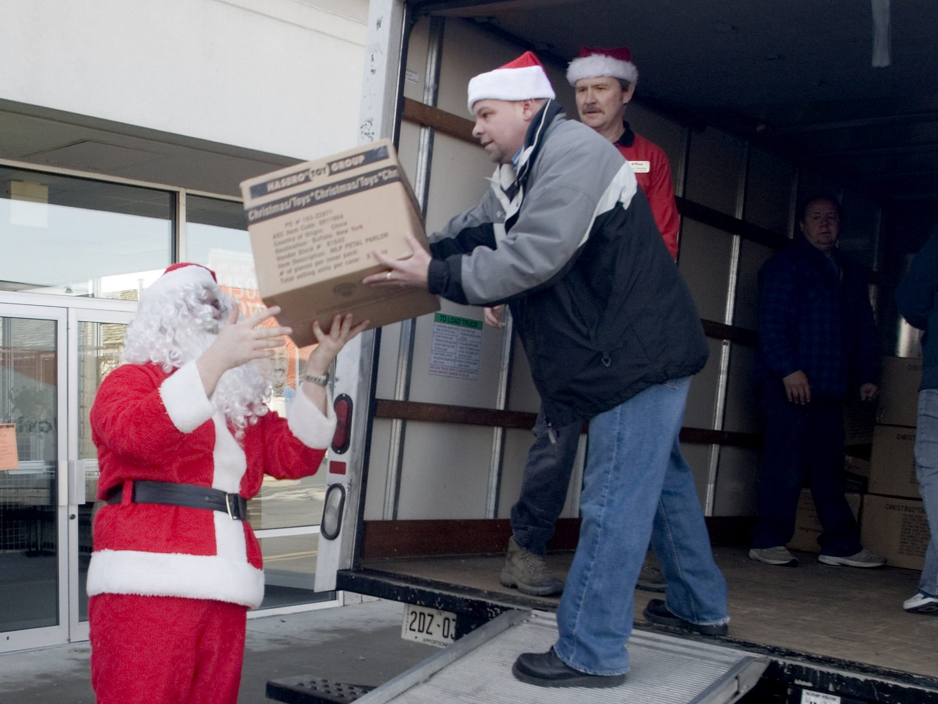 In 2006, Tops boosts Salvation Army Tops Friendly Markets employees Jeremy Stone, left, dressed as Santa Claus, Jim Butts, center, and Tom Petzke load a truck with $5,000 worth of toys donated to the Salvation Army. The toys, along with a $1,100 donation, were paid for by donations from store customers in Elmira and Big Flats.