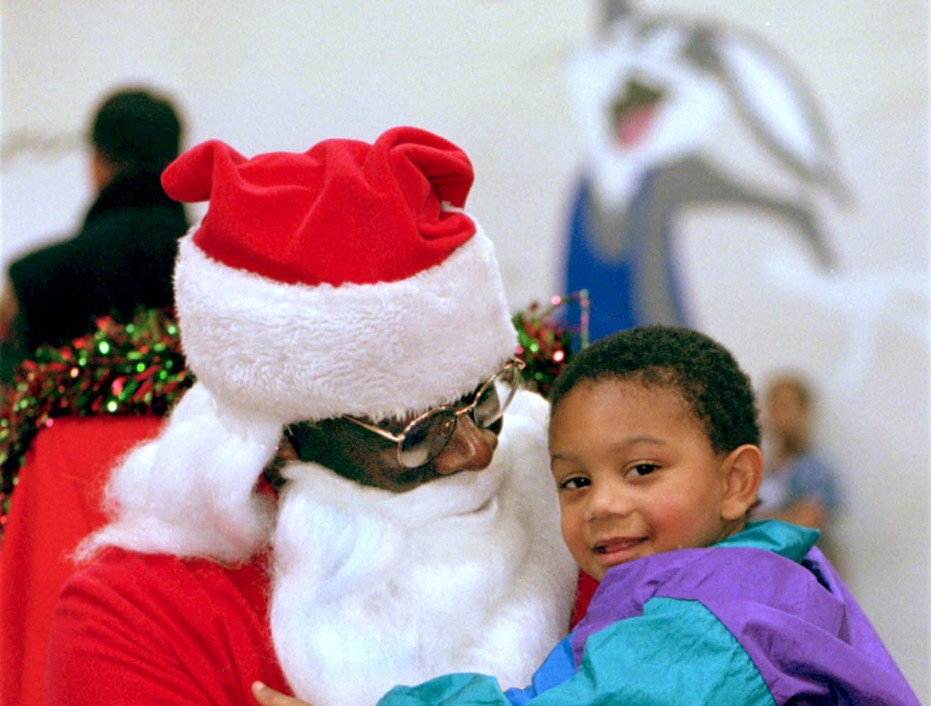-  -12/20/98, 1C: Saquan Guest, 2, of Elmira visits with Santa at the Christmas party Saturday at the Ernie Davis Community Center