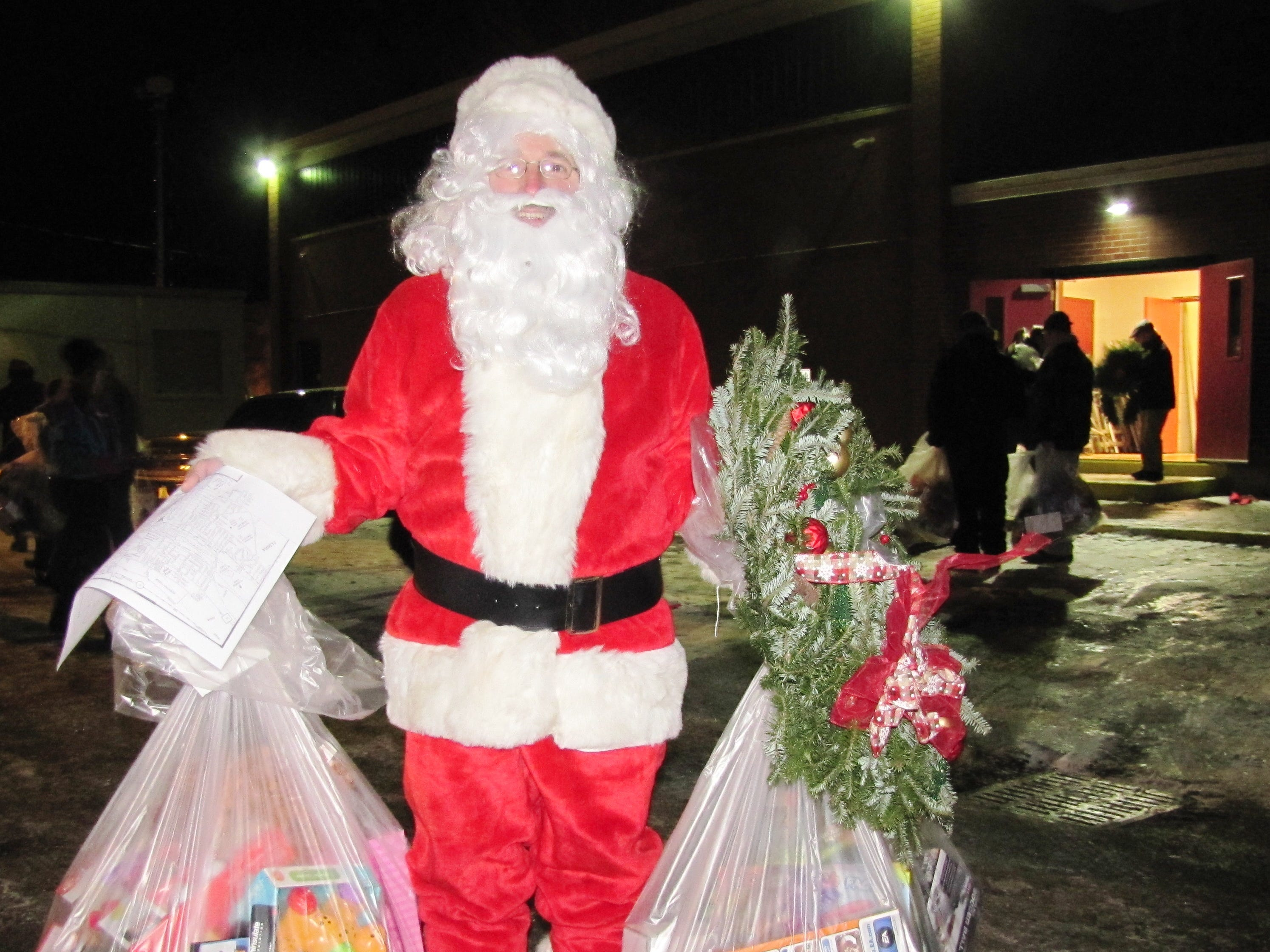 Lynn Thomas, of Painted Post, a native of Elmira, delivered Arctic League gifts Christmas morning in a full Santa suit.