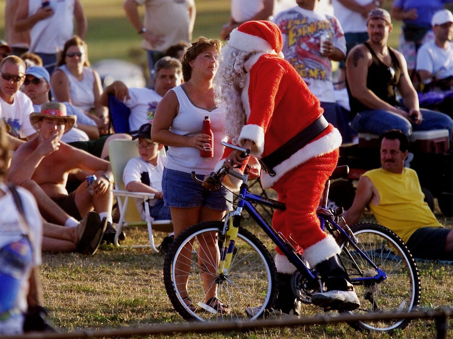 -  -Santa Claus talks to a fan at WGI on Friday evening during the Bull Hill Vineyards 250.