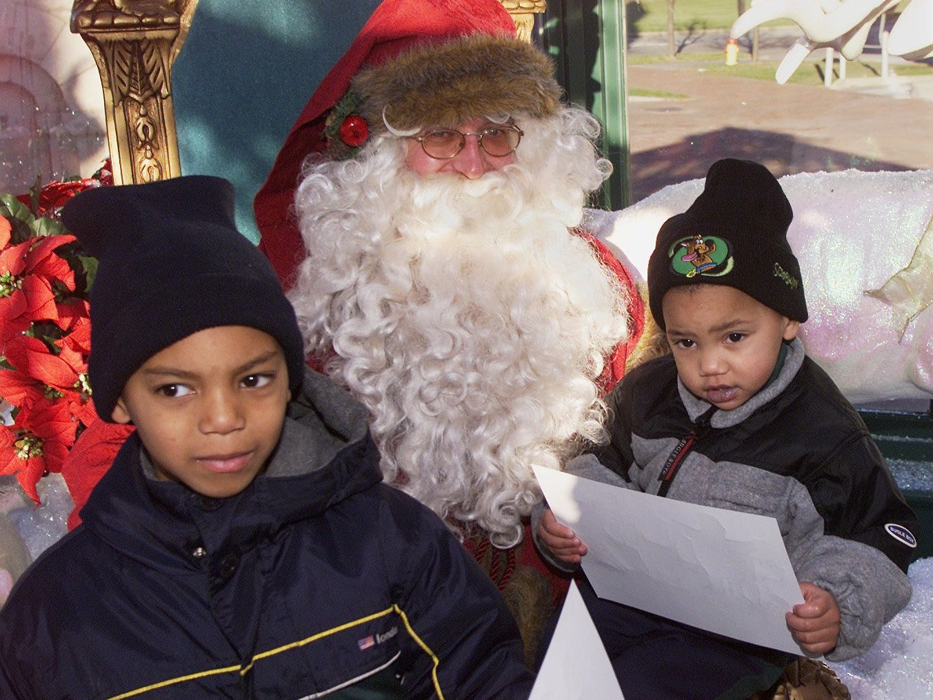 In 2000, Daron Fulmer, 6, left, and his brother Darius, 2, both of Elmira, visited Santa Claus in downtown Corning during the Crystal City Christmas festivities.