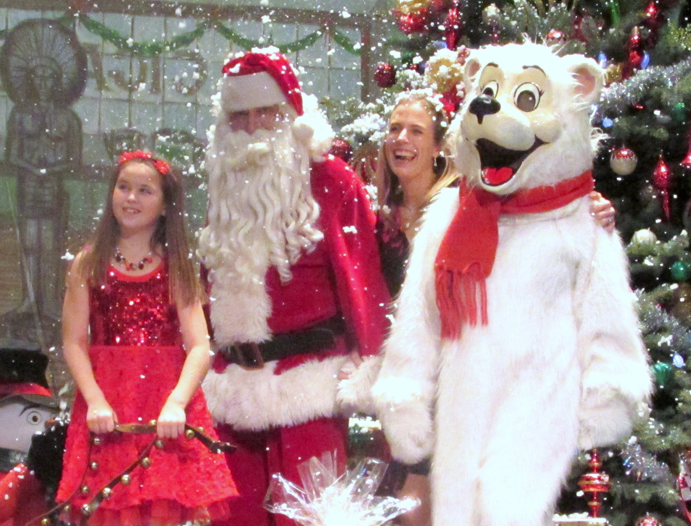 Arctic League bell ringer Riley Fesetch, left, and Christina Bruner join Santa and the Arctic League mascot during the finale of the annual broadcast at the Clemens Center in Elmira in 2015.