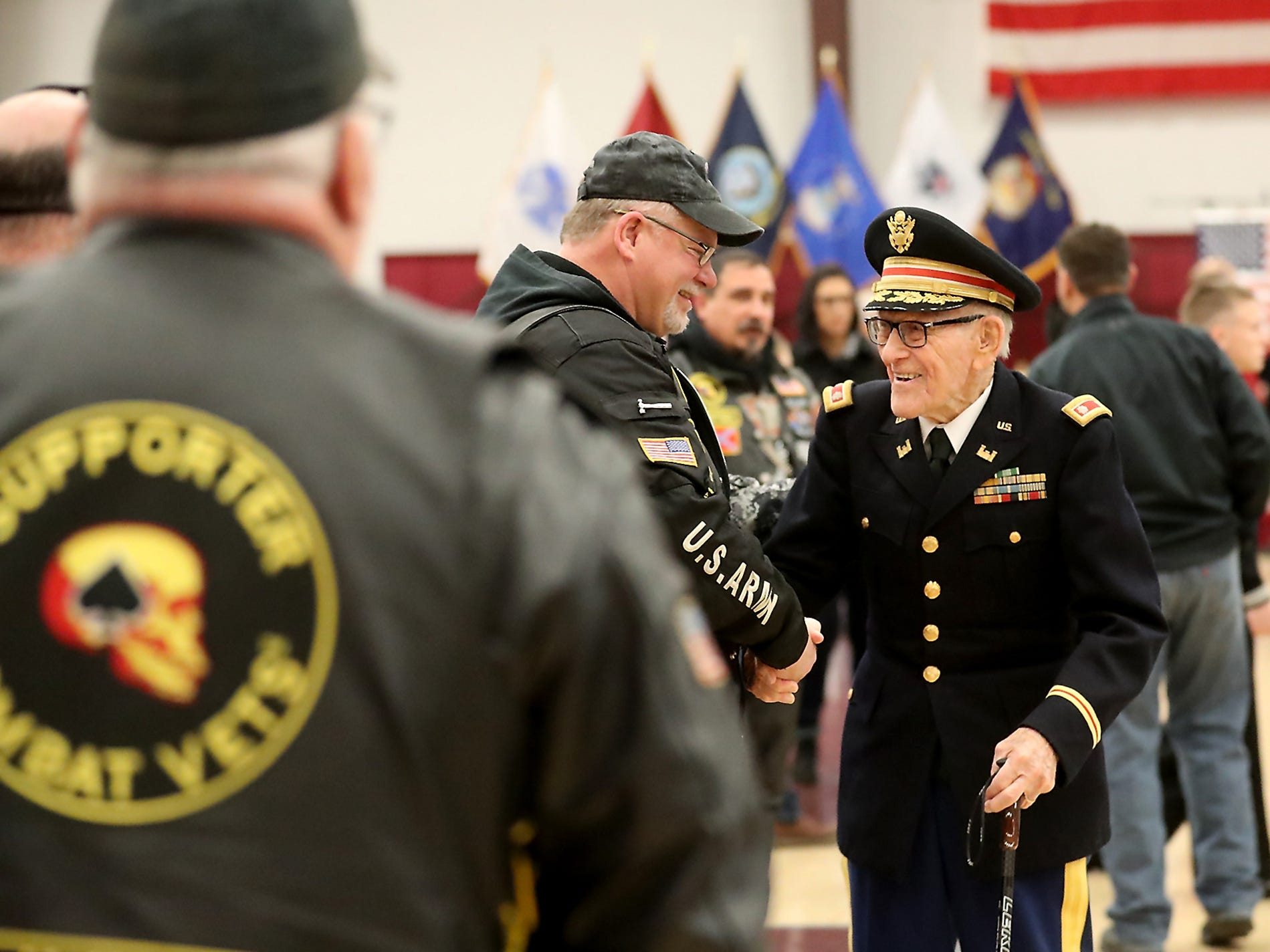 World War II Veteran Vernon Frykholm (right), shakes hands with attendees after the conclusion of the Honoring All Who Served Veterans Day ceremony at the Kitsap Sun Pavilion on Monday, November 12, 2018. Fyrkholm, who is 102-years-old resides in Sequim.