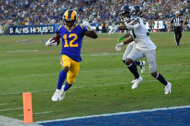 Los Angeles wide receiver Brandin Cooks scores the touchdown that gave the Rams a 12-point cushion in the fourth quarter.