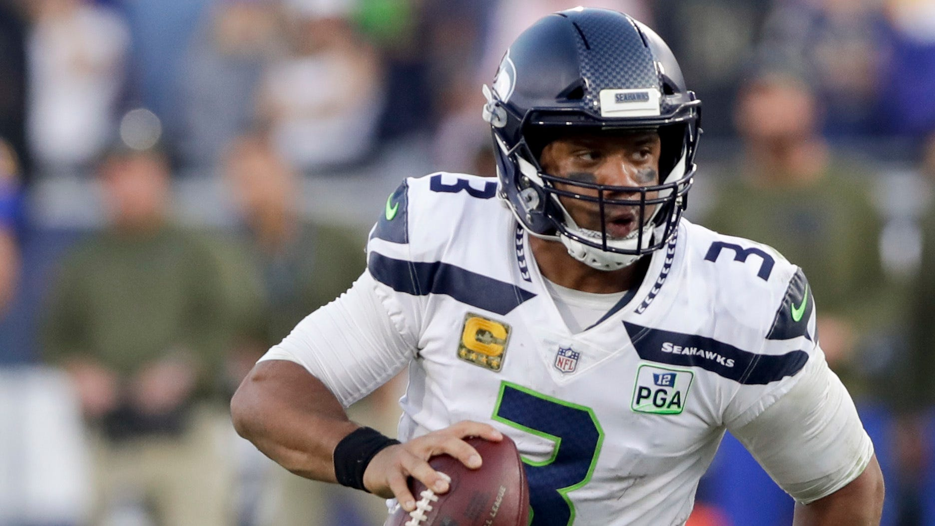 Seahawks quarterback Russell Wilson looked like his younger self on Sunday against the Rams, rushing for 90 yards.