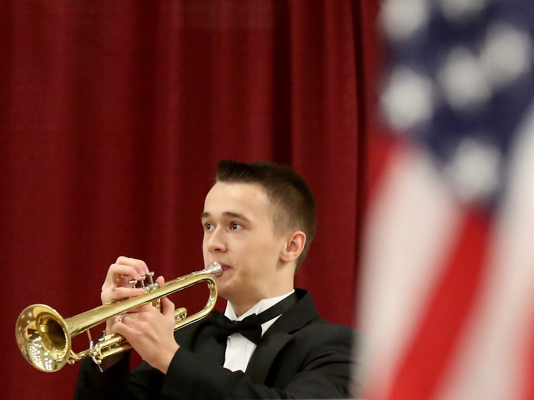 Spencer Allen, of the Bremerton High School Wind Ensemble, plays one half of Echo Taps at the closing of the Honoring All Who Served Veterans Day ceremony at the Kitsap Sun Pavilion on Monday, November 12, 2018.