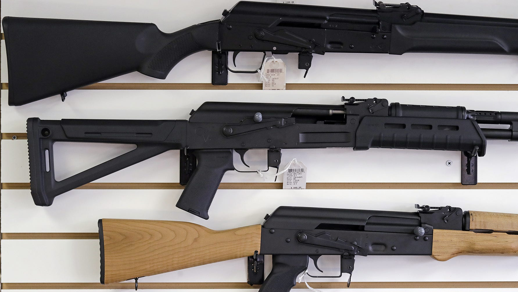 Washington gun shop owners expect sales to rise after voters approved Initiative 1639, which adds restrictions to the purchase of semi-automatic rifles.