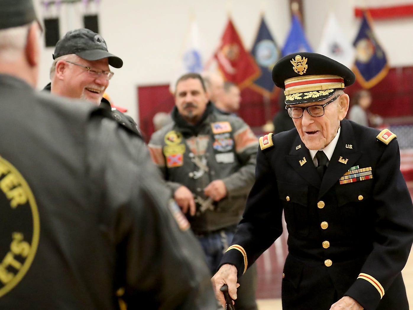 World War II Veteran Vernon Frykholm, shakes hands with attendees after the conclusion of the Honoring All Who Served Veterans Day ceremony at the Kitsap Sun Pavilion on Monday, November 12, 2018. Fyrkholm, who is 102-years-old resides in Sequim.
