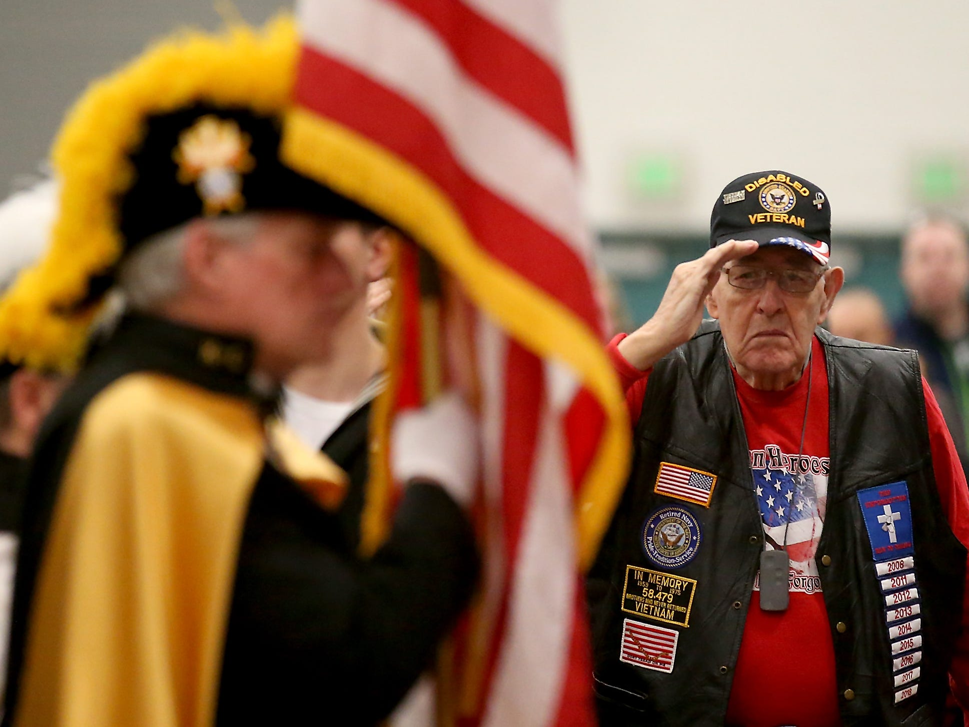 Veteran William Lilley, of Silverdale, salutes the flag as the Knights of Columbus present the colors at the start of the Honoring All Who Served Veterans Day ceremony at the Kitsap Sun Pavilion on Monday, November 12, 2018.