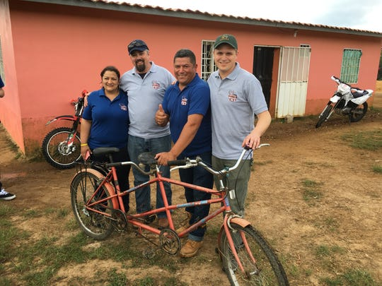 Andy Gibbon, right, and Josh Gibbs, second from the left, spend time on a coffee farm near Marcala, Honduras with Oscar Omar Alonzo and Liliana Cardona. The farm is owned by Alonzo, who has grown coffee used by Dynamite Roasting Co. for years.