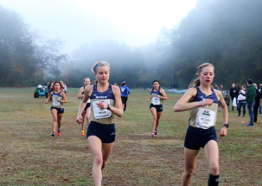 Freshman Skyler Tait (left) and sophomore Lydia Wilson paced the Cavaliers' women's team at the AAC Championships