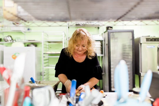 Beth Hazley, owner of Two Chicks and a Pot catering, said she oversees everything that goes on in the kitchen.