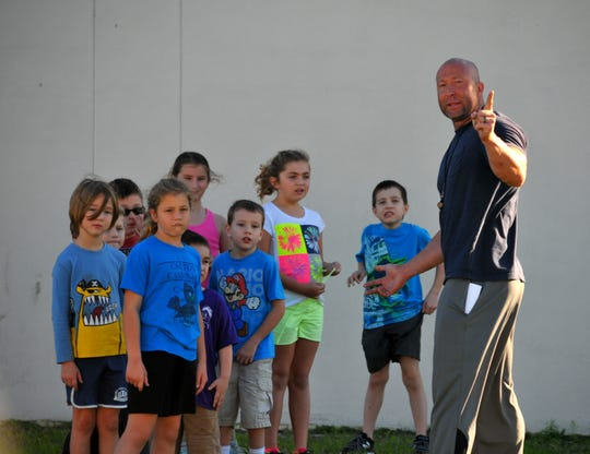 Reed Tompkins instructs some students during one of his classes.