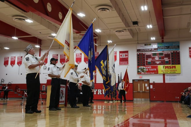 The flags of every branch of the armed forces were displayed during the ceremony on Veterans Day.