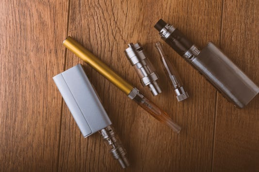 Vape Pen Mod E Cigarette E Cig On A Wooden Background