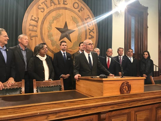 State Rep. Dennis Bonnen, center, claims victory in the race for Texas House speaker.