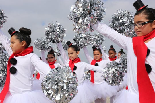 Yeager Elementary Junior Tigerettes Dance Team, led by Yesenia Garcia, run through their routine before entering the 33rd annual Harbor Light Festival parade at starting point Sherrill Park in Corpus Christi, Texas on Saturday, December 6, 2014. This is their third year participating.