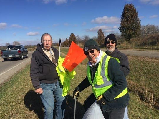 Members of the Democratic Club of Ross County clean up Veterans Parkway Saturday morning as part of a Veterans Day weekend event.