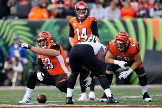 Cincinnati Bengals center Billy Price (53) and Cincinnati Bengals offensive guard Clint Boling (65) get set on the line of scrimmage during a Week 10 NFL game between the New Orleans Saints and the Cincinnati Bengals, Sunday, Nov. 11, 2018, at Paul Brown Stadium in Cincinnati.