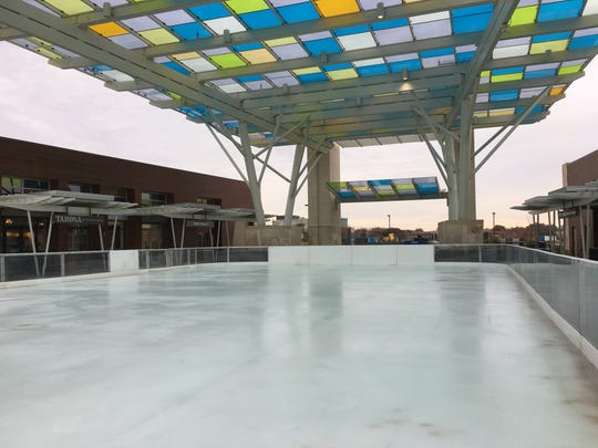 Workers have the ice rink at Blue Ash's Summit Park ready for the season. It opens Nov. 17