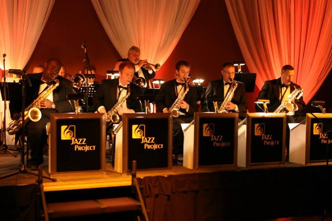 "In the intimate setting of the Roxy Regional Theatre, The Jazz Project will present music from many of the popular big bands of the 1940s, including Count Basie, Glenn Miller, Woody Herman and Gene Krupa.  The evenings' featured vocalist will be Sarah Queen, singing such all-time favorites as ""'S Wonderful,"" ""I've Got A Gal in Kalamazoo,"" ""As Time Goes By,"" ""Stomping at the Savoy"" and ""Chattanooga Choo Choo."""