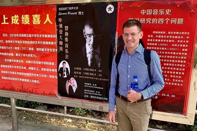 Austin Peay Dr. Spencer Prewitt stands by his billboard in China.