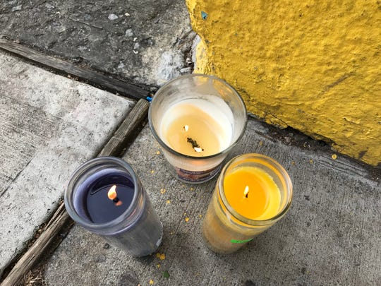Memorial candles set up outside a store for Benjamin Nord who was fatally shot on Liberty Street in Plainfield Sunday night.