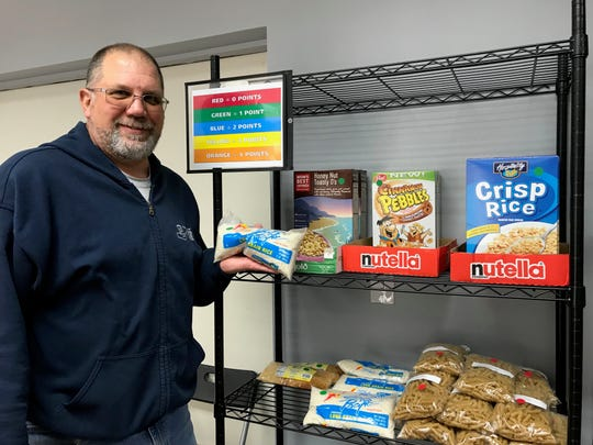 Frank Hasner, Franklin Food Bank executive director in the new client choice section of the food pantry where clients are able to select the food they want as part of a pilot program.