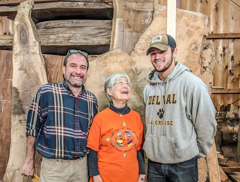 With Mira Nakashima are Del Val woodworking teacher Josh Paul and senior Jack Bender, who is currently working on a Nakashima-influenced project.