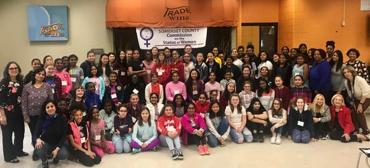 Freeholder Pat Walsh, seated at far right, is pictured with girls who participated in the third annual STEM program sponsored by the Somerset County Commission on the Status of Women. Also pictured, at left, are SCCSW Commissioners Stella Ayala, Smriti Agrawal and Aparna Virmani; at right are Commissioners Beverly Briggs-Lawson, Vaseem Firdaus and Marti Kalko, and Commission Chair Janice Fields.