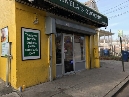 Memorial candles have been set up outside Canela's Grocery on Liberty Street where Benjamin Nord was fatally shot Sunday night.