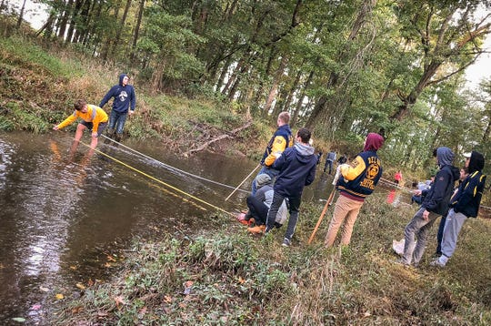 Taking a deep dive into the health of Lockatong Creek in Kingwood Township, the Environmental Science students of Delaware Valley High School were glad to get out of the classroom and into the environment.