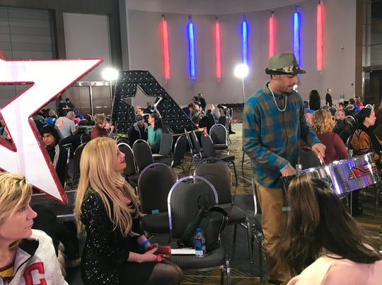 Aaron Soulbrave Parrott of Detroit  plays the steel drum as Jenelle Faranso, a singer from West Bloomfield, looks on at the 'America's Got Talent' audition on Monday, November 12, 2018 in Detroit.