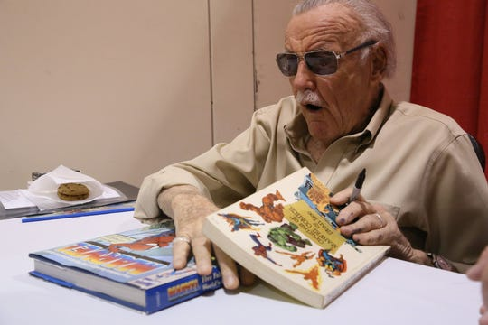 Stan Lee, former president and chairman of Marvel Comics, signs autographs at the Motor City Comic Con 2013 at Suburban Collection Showplace in Novi, Mich. on Saturday, May 18, 2013. Kimberly P. Mitchell/Detroit Free Press
