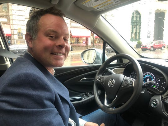 Scott Goddard, senior manager of General Motors Marketplace, in a Buick equipped with the in-vehicle Marketplace app.