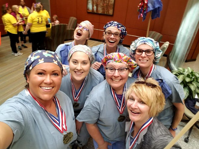 St. Joseph Mercy Livingston nurses participate in the second annual regional Nurses Olympics, in which nurses across all five St. Joe's hospitals compete in events such as ski and scoot and rhythmic gymnastics during Nurse's Week.