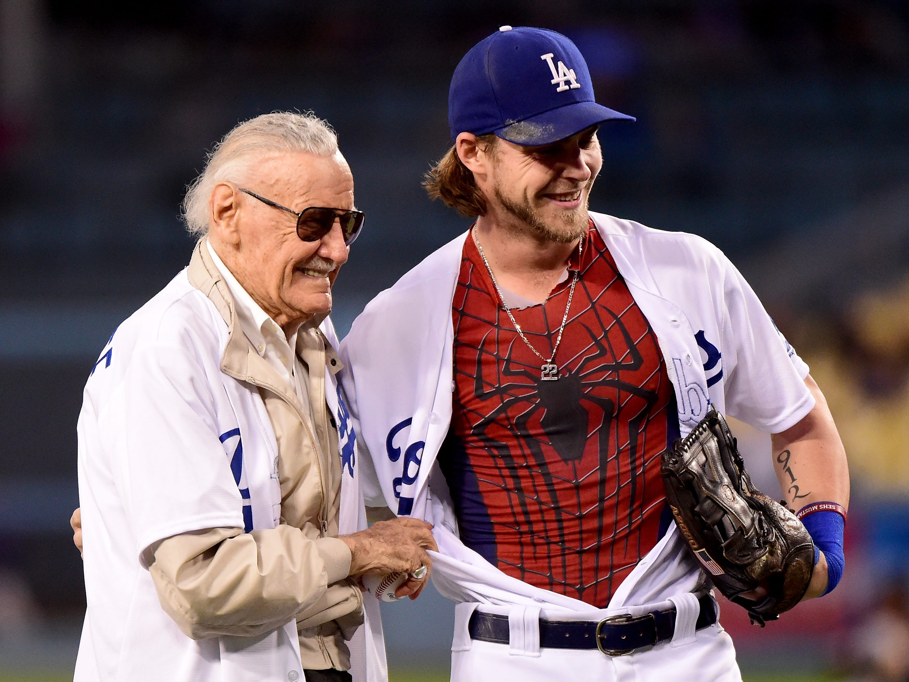 Josh Reddick  of the Los Angeles Dodgers poses with comic book mogul Stan Lee before the game against the Colorado Rockies at Dodger Stadium on September 22, 2016 in Los Angeles.