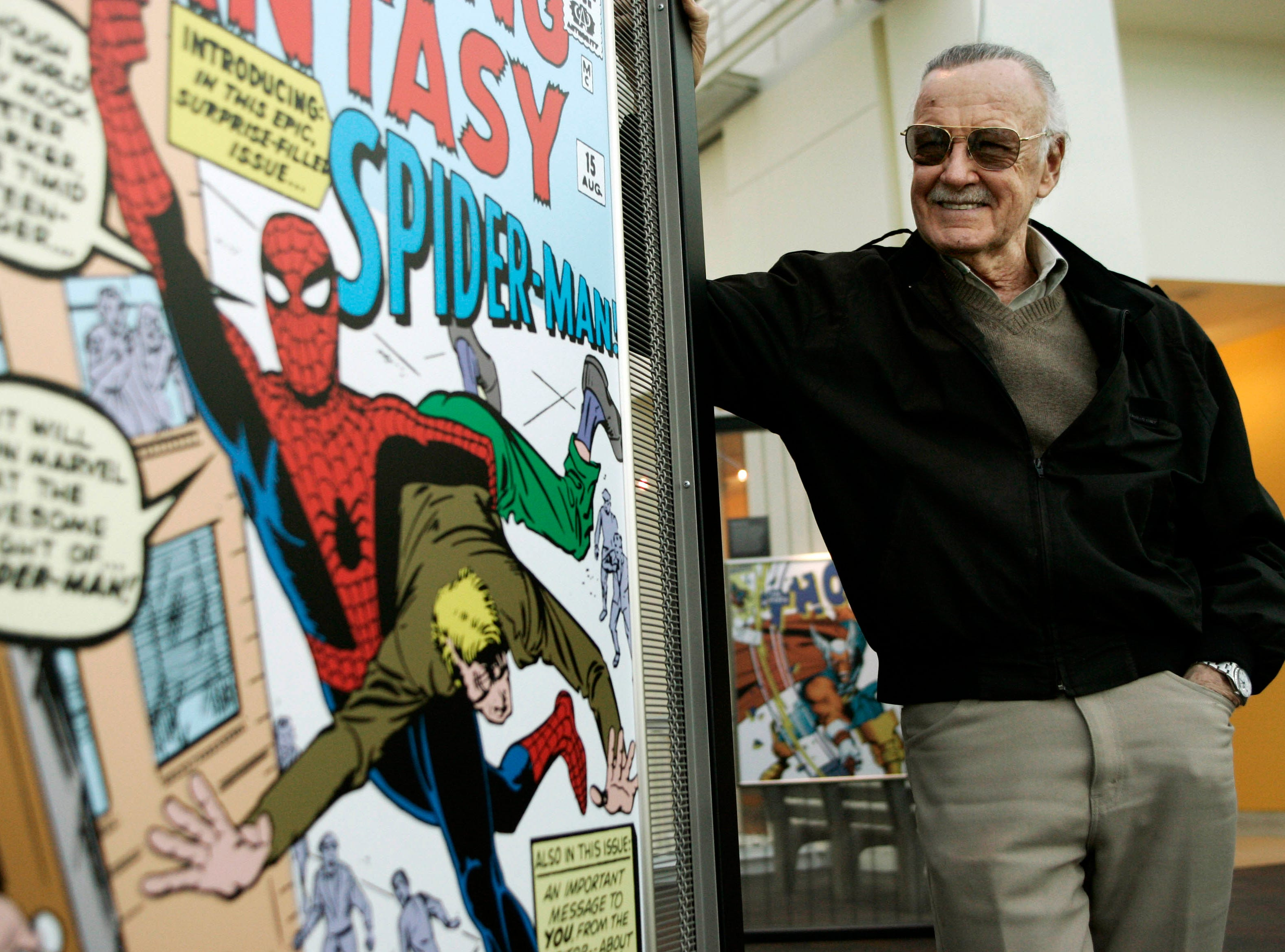 Comic book creator Stan Lee stands beside some of his drawings in the Marvel Super Heroes Science Exhibition at the California Science Center in Los Angeles  in 2006.
