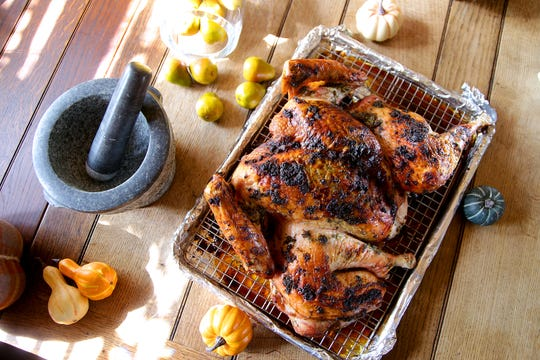 Pictured here is the turkey on one sheet pan, with a wire rack for drainage. (Kirk McKoy / Los Angeles Times)
