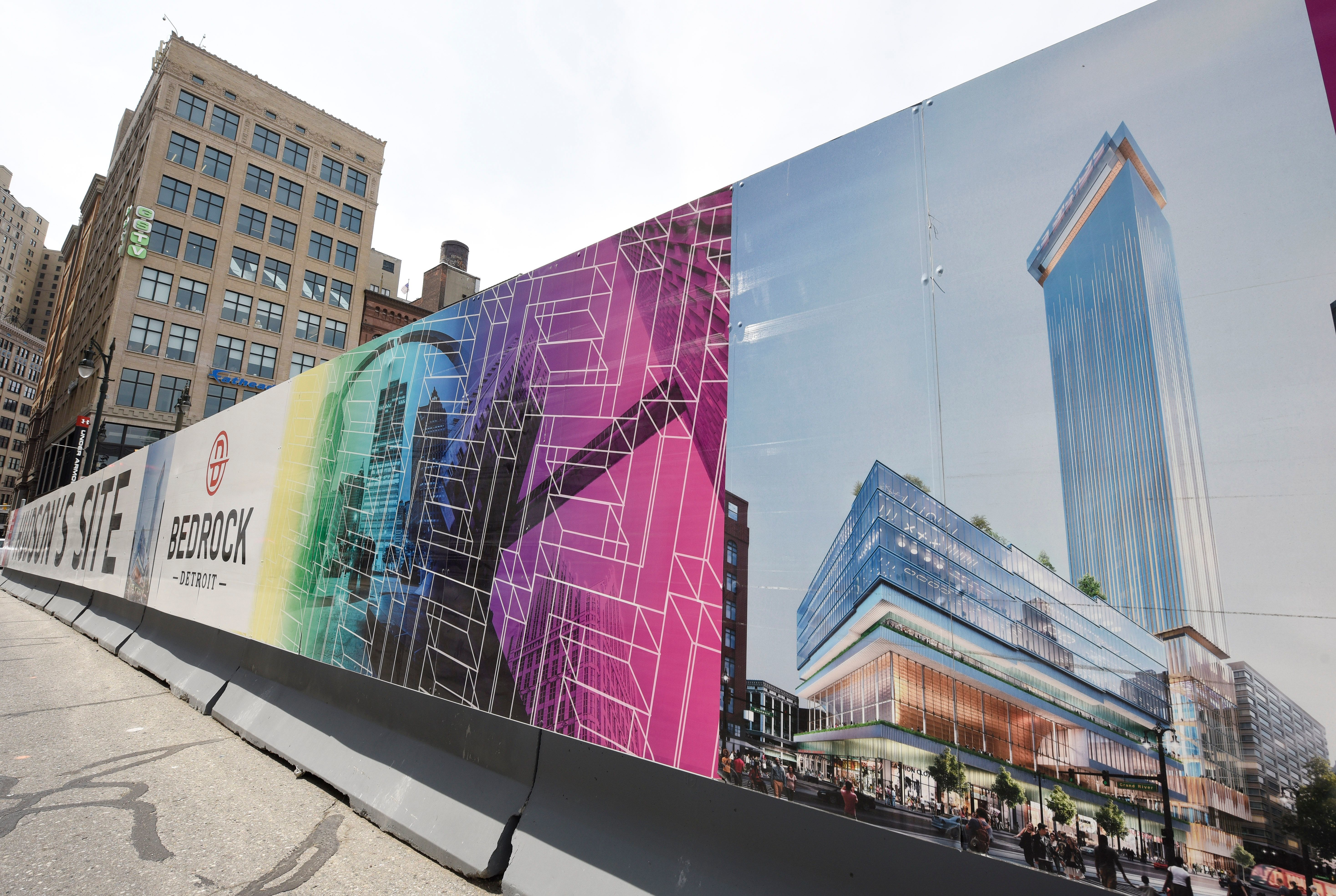 A rendering of the tower and mixed-use building that will be constructed on the Hudson's site adorns Bedrock's sign at Woodward at Gratiot.