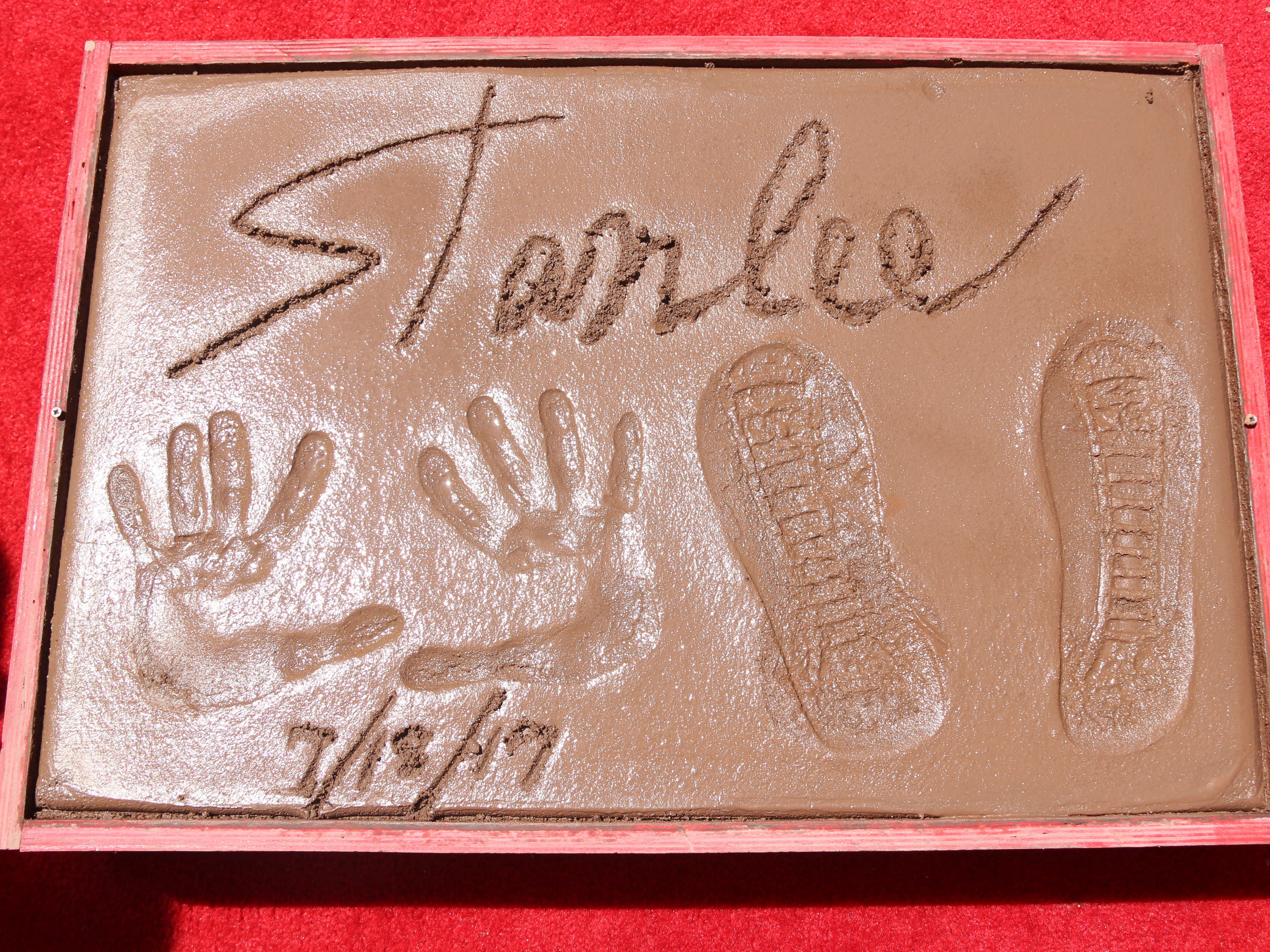 Stan Lee places his feet and hands in cement at his hand and footprint ceremony at the TCL Chinese Theatre  in , 2017 in Los Angeles.