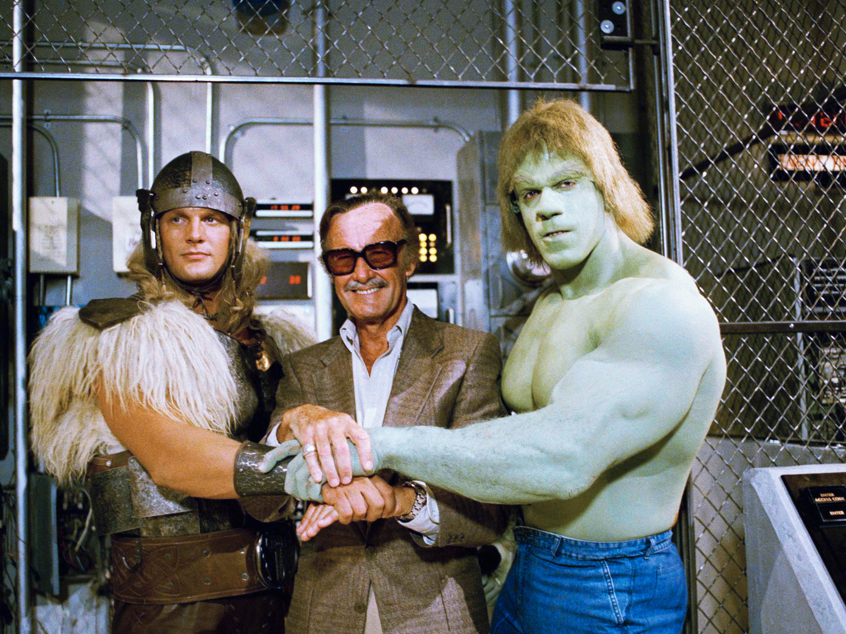 "Comics impresario Stan Lee, center, poses with Lou Ferrigno, right, and Eric Kramer, who portray The Incredible Hulk and Thor, respectively, in a special movie for NBC, ""The Incredible Hulk Returns,"" May 9, 1988,   in Los Angeles, Calif. Lee says the secret of successfully transferring comic book characters to television is to avoid making it a carbon copy."