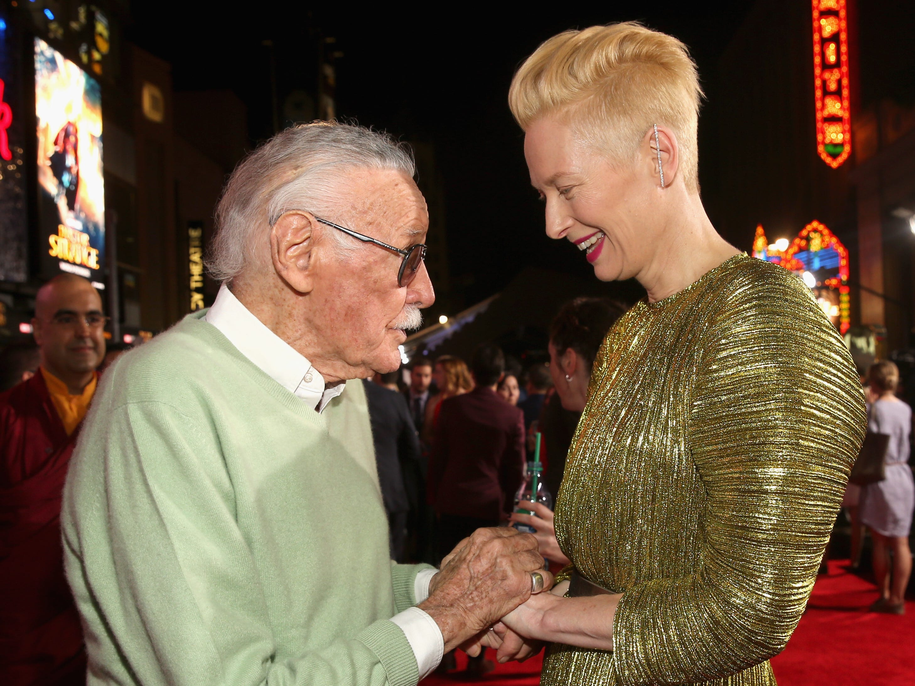 "Executive producer Stan Lee talks to actress Tilda Swinton at the World Premiere of Marvel Studios' ""Doctor Strange"" in Hollywood in 2016."