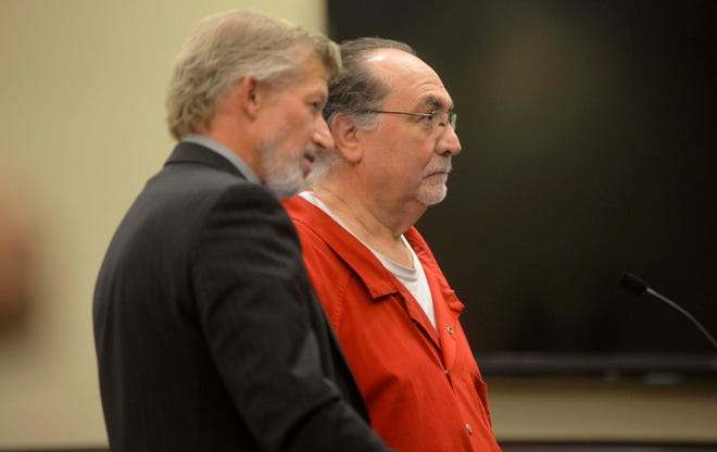 Wendell Popejoy Jr. stands with his lawyer Jeff Kortes to hear his sentence of life in prison for the murder of his neighbor Sheila Bonge on Nov. 5 in 20th Circuit Court in Grand Haven.