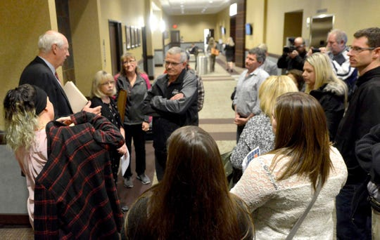 Prosecutor Ron Frantz talks to victim Sheila Bonge's family after Wendell Popejoy Jr. was sentenced to life in prison on Nov.  5 in Grand Haven.