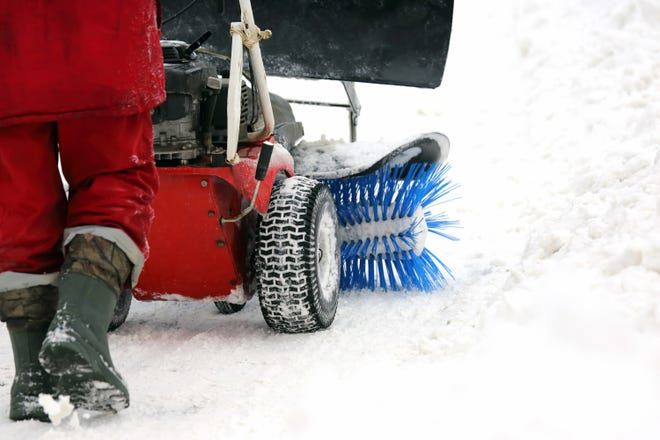 Snow removal companies handle clearing out sidewalks and driveways, sometimes before you even wake up. (Dreamstime)