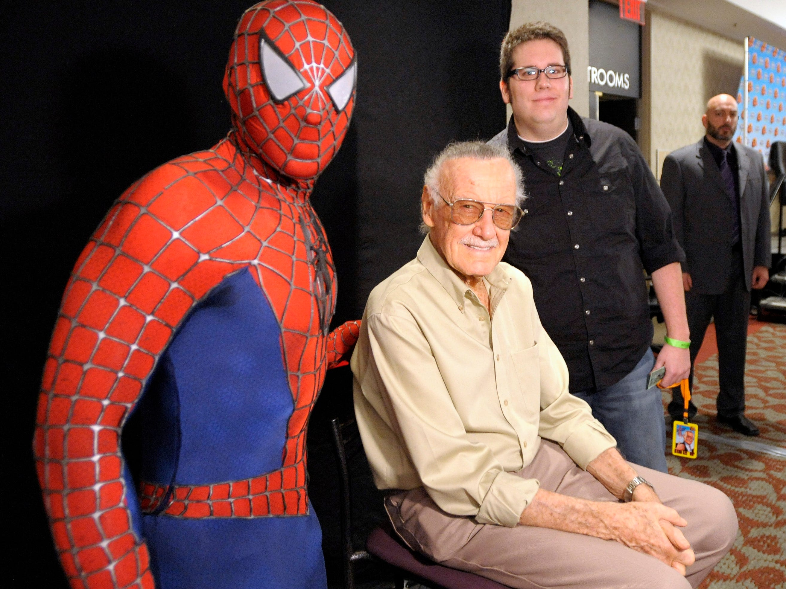 Nik Kaldobsky, left, of Livonia, wears his Spider-Man costume as he and friend Garrett Knack, right,  of Novi, pose with Spider-Man creator Stan Lee, at the 1st Annual/4th Anniversary New Detroit Fanfare 2010 comic book convention at the Dearborn Hyatt Regency Hotel, October 30, 2010.