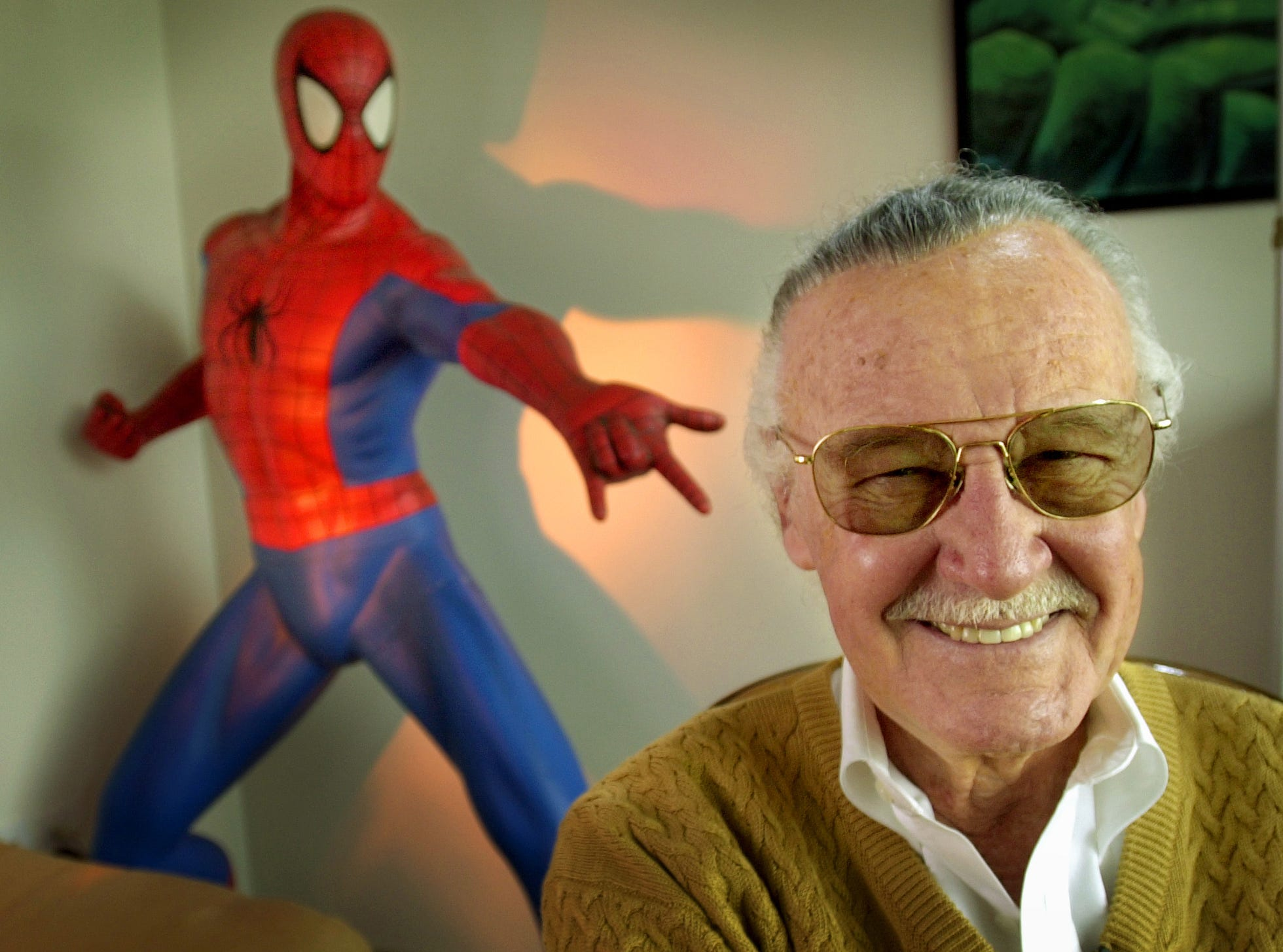 "Stan Lee, creator of comic-book franchises such as ""Spider-Man,"" ""The Incredible Hulk"" and ""X-Men,"" smiles during a photo session in 2002 in Santa Monica, Calif.  The mogul who revolutionized the comic book and helped make billions for Hollywood died Monday in Los Angeles at age 95."