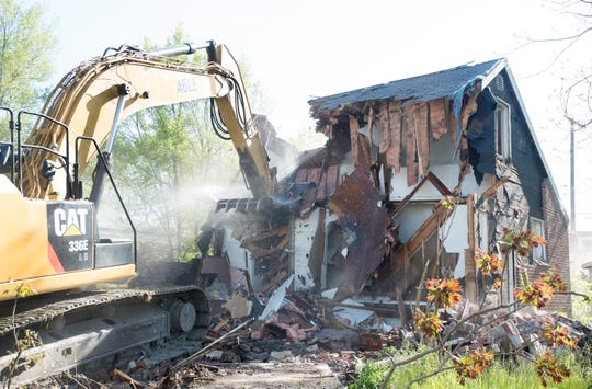 Demolition of an unoccupied house at 9848 Hayes in Detroit, Michigan on May 19, 2016.